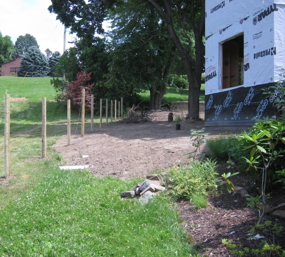Fence erected by my neighbor next to the addition going up