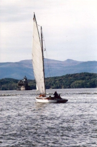 Eleanor sailing towards the Hudson-Athens Lighthouse
